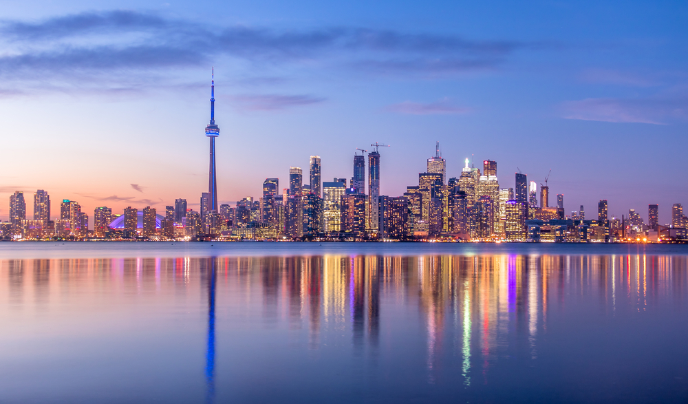 Toronto skyline at sunset with reflection of skyscrapers in the water