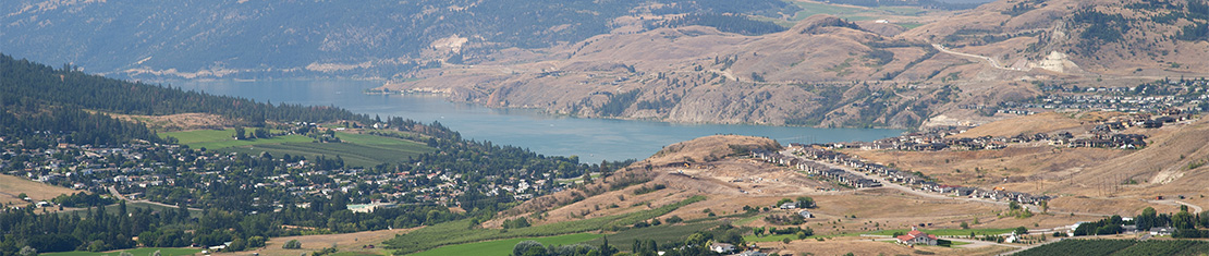 Okanagan lake surrounded by yellow hills.
